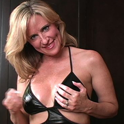 Appealing milf gives jerk off instruction. She knows just what she wants.  None of this young girl teasing.  She could be your aunt or your moms friend.